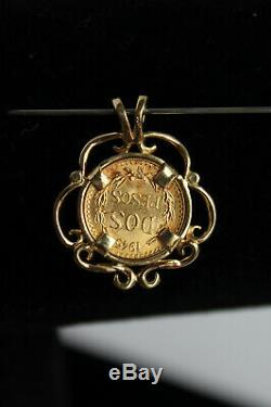 14 Kt Yellow Gold Pendant With A 2 Pesos Mexican. 900 Fine Gold Coin